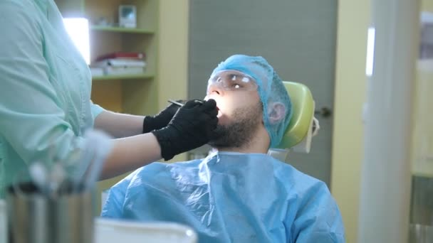 Dentistry - male patient at stomatology clinic