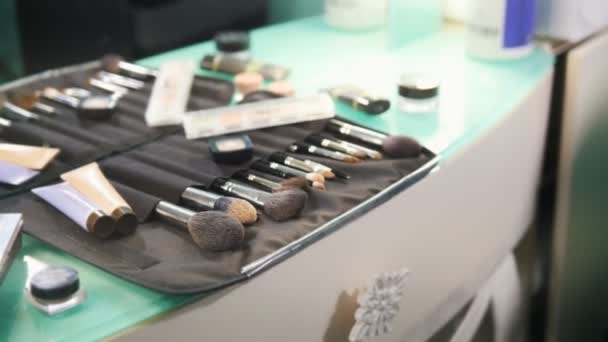 Professional cosmetics makeup brushes kit in beauty salon