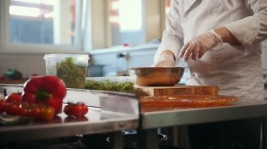 Chef preparing a salad in the kitchen of the restaurant
