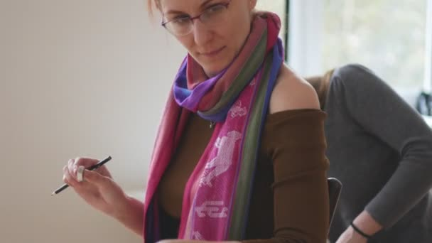 Female painter draws sketches in art studio