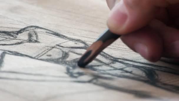 Hands of female artist draws sketces of nude model