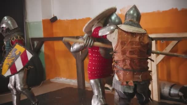 Four men knightes having a training fight in the gym
