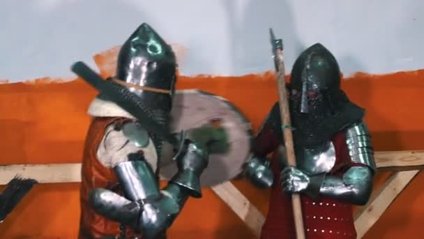 Knights training - two men knightes having an aggressive training fight