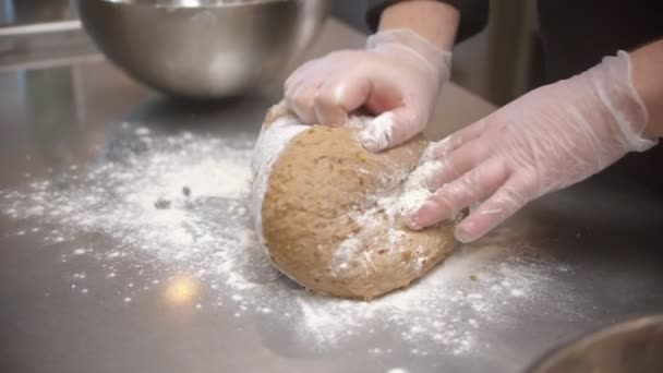 Chef making dough for bread baking on the restaurant kitchen
