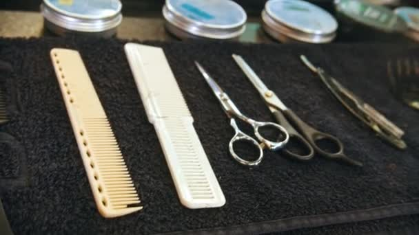 Barber collection of scissors and combs lying on the cloth