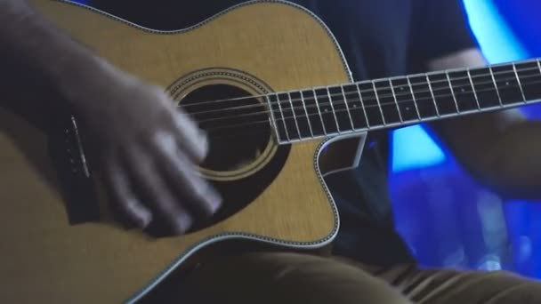 man playing guitar close up. Acoustic, classic, wooden guitar. Musician plays