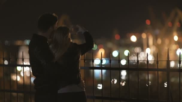 attractive couple in love embrace and enjoy an intimate moment together, against the backdrop of port lights