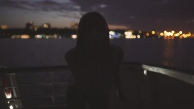 silhouette young attractive woman background night city boat