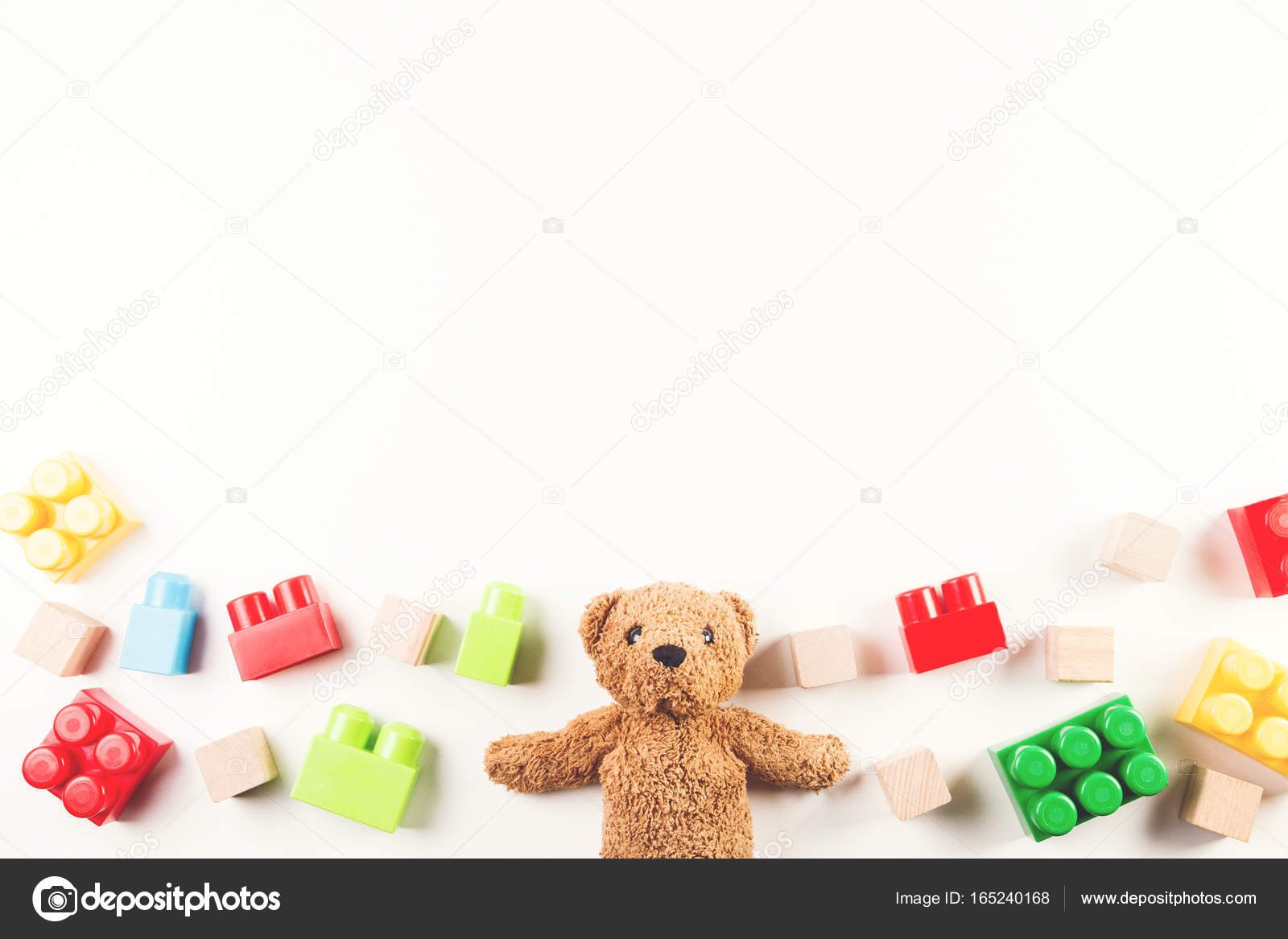 Kids Toys Background With Teddy Bear And Colorful Blocks Stock