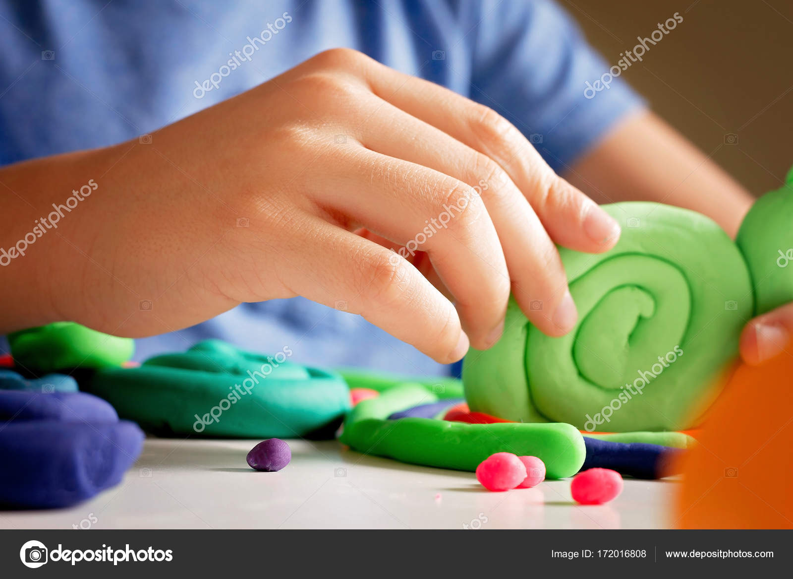 Child Hands Making Toy Figure With Modeling Clay Or Plasticine