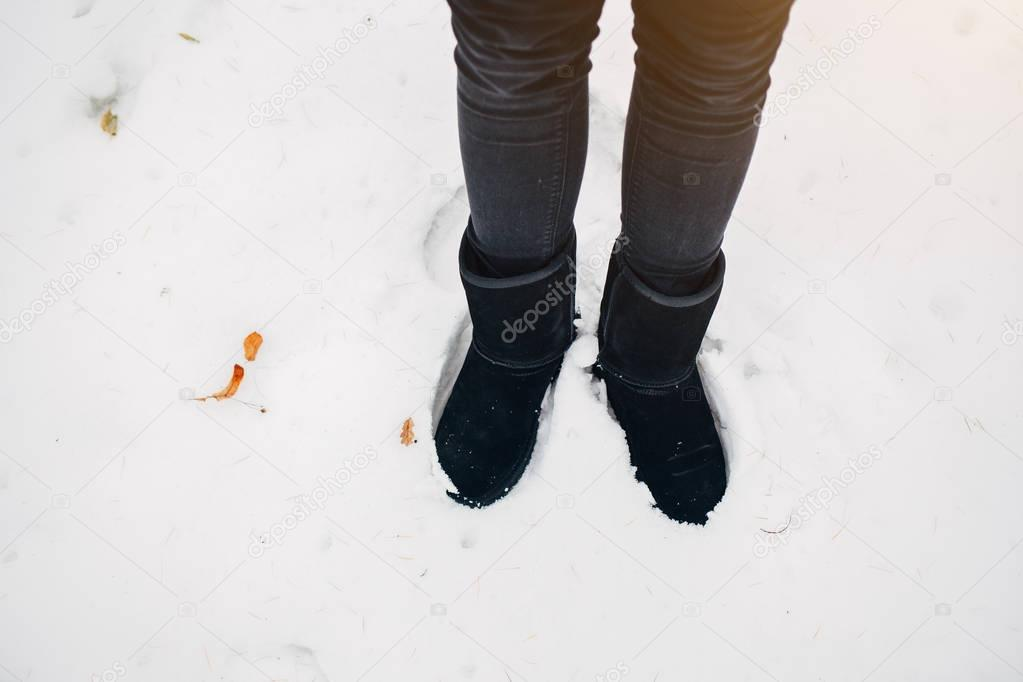 Woman's feet on the snow
