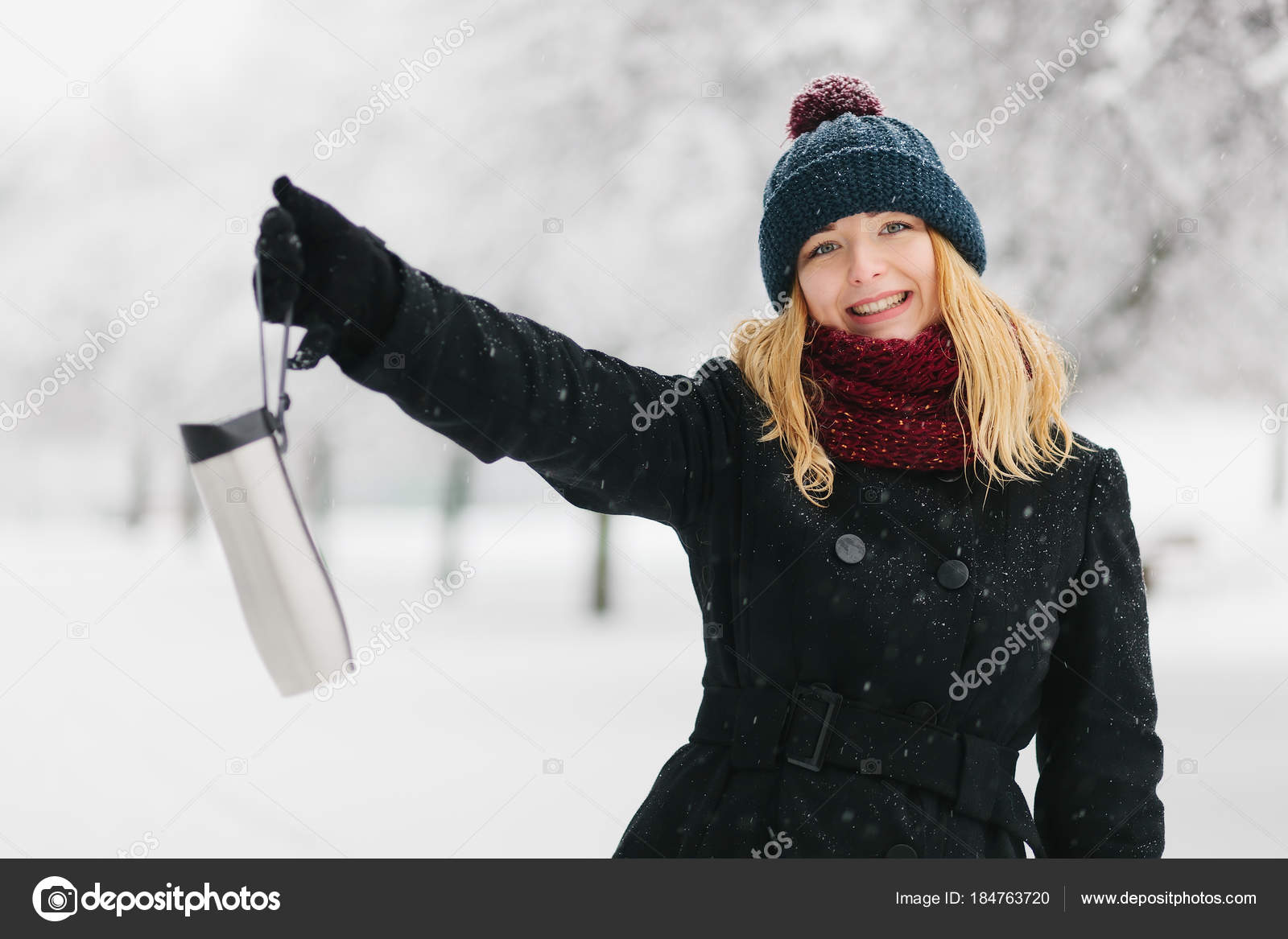 b47217049 Young caucasian blonde girl in black coat and red knitted scarf ...