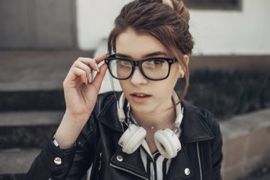 Outdoor Summer Portrait of Young Beautiful Girl in Black Leather Jacket and Trendy Black Glasses