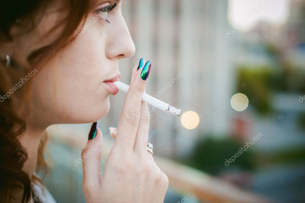 https://st3.depositphotos.com/8565368/12663/i/950/depositphotos_126630348-stock-photo-girl-with-a-cigarette.jpg