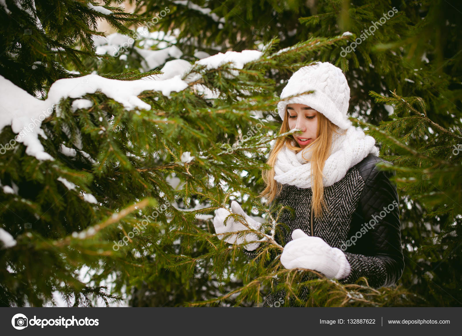 5d4facef4 Portrait of cute woman in white scarf and hat knitted coat on outdoors  background of snow