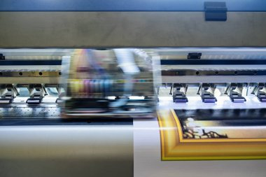 Printer machine inkjet during production on vinyl