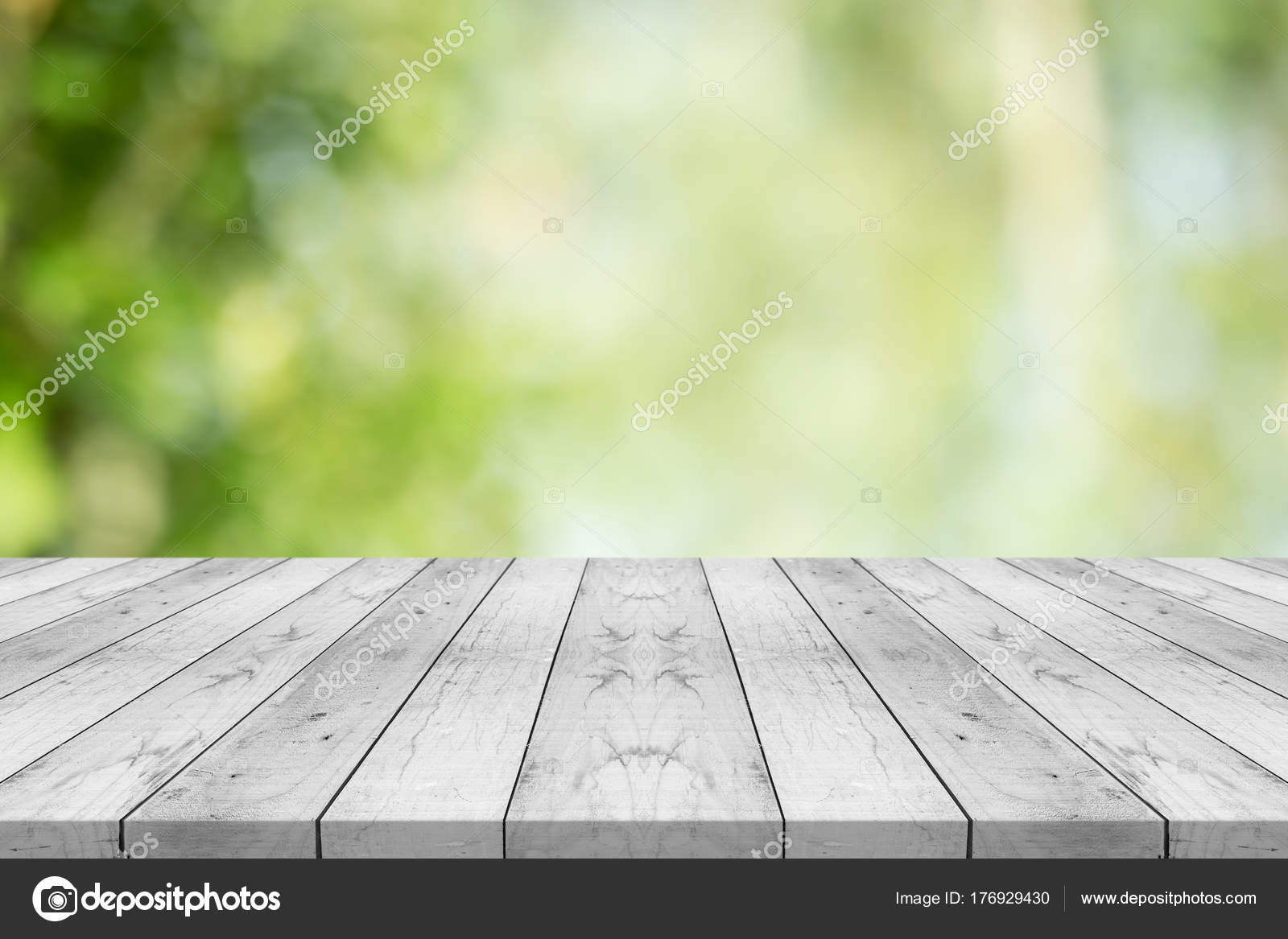 table top background wood empty white wood table top on nature green blurred background stock photo