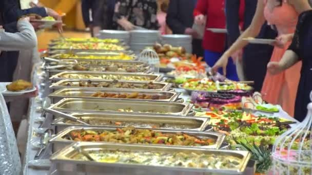 buffet table: guests take food