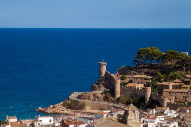 View of the town of Tossa de mar one of the most beautiful towns on the Costa Brava. City walls and medieval castle on the hill. Amazing city in Girona, architecture and monuments of Catalonia.