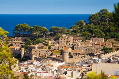 View of the old town of Tossa de mar and castle on the hill. Architecture Costa Brava of Catalonia.