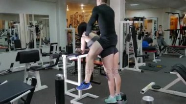 Strong woman is training with a partner