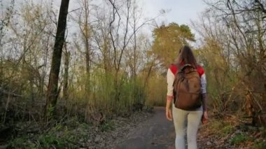 She travels through the woods