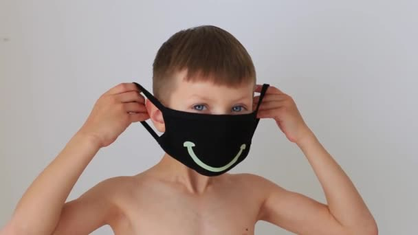 Boy puts on a quarantine respiratory mask at home