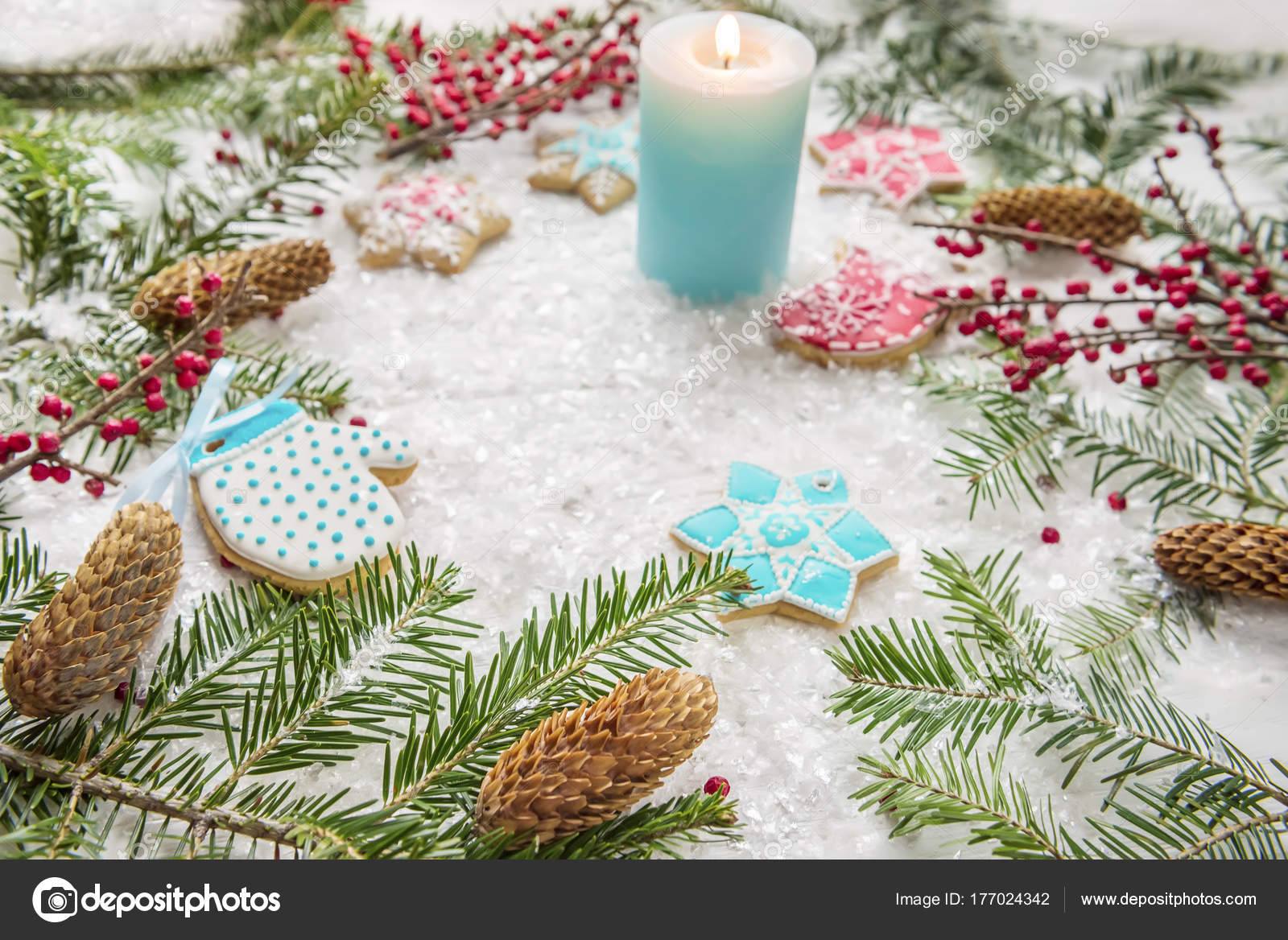 festive christmas new years screensaver postcard background homemade bright gingerbreads branches of a christmas tree snow and a burning candle on a