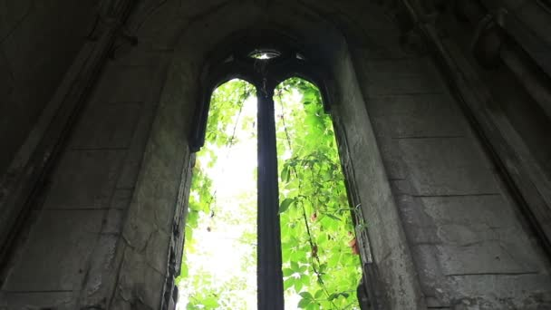 Window opening in ancient stone crypt at graveyard