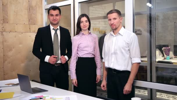 Confident business team fold hands the office