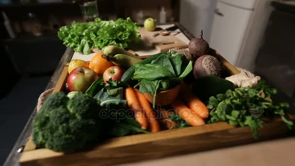 Set of fresh vegetables and fruits on wooden tray