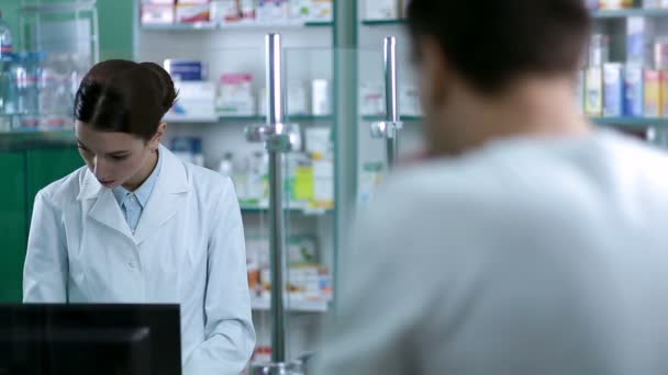 Female pharmacist counseling customer in pharmacy