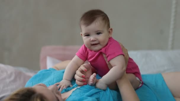 Portrait of excited baby infant laughing in bed
