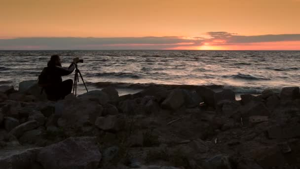 Skillful photograper shooting sea in twilight time