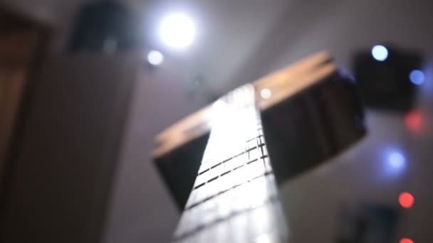 Musician playing acoustic guitar and singing