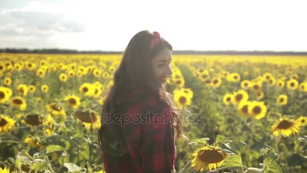 Playful girl relaxing in sunflower field