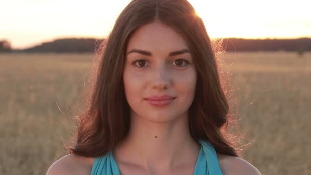 Summer portrait of charming woman at sunset
