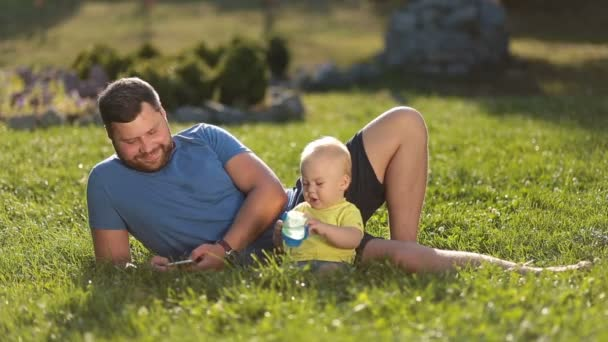 Smiling father and son enjoying leisure outdoors