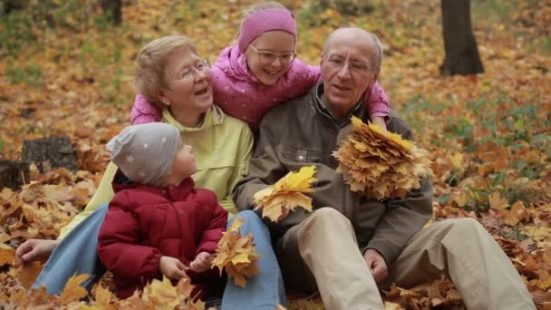 Multi generation family relaxing in autumn park
