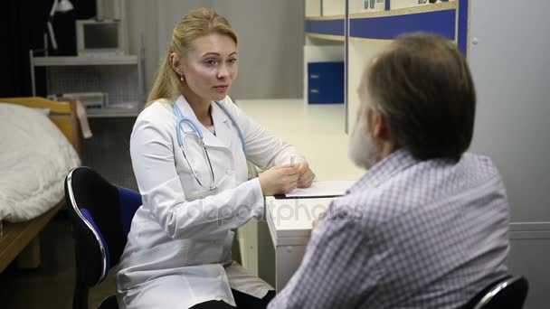 Female doctor asking senior patient for symptoms