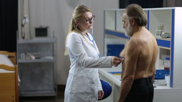 Female doctor using stethoscope to exam patient
