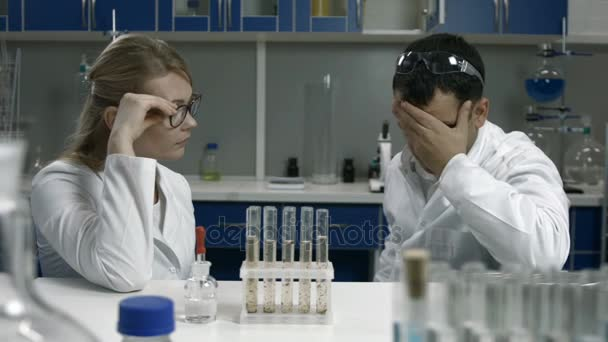 Pensive Scientists Thinking Over Bad Results Stock Video