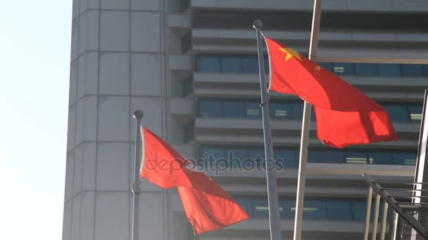 Flags of China and Hong Kong waving in the wind