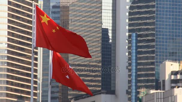Flags of China and Hong Kong flying in the wind