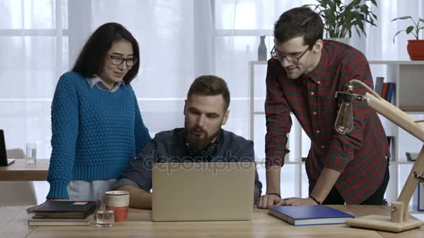 Business team works on project together at office