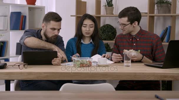 Creative businesspeople analyzing documents