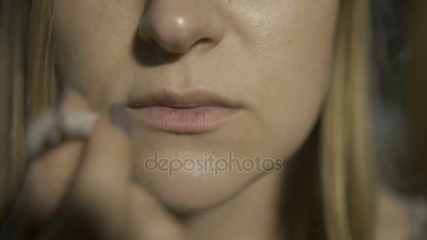 Extreme close-up of woman smoking cannabis joint