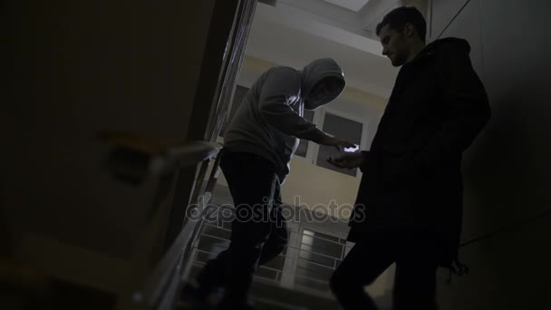 Drug addict buying drugs from dealer on stairway
