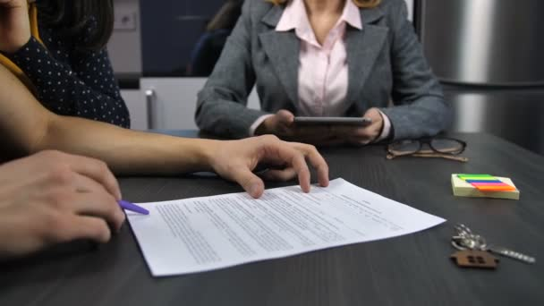 Husbands hands signing mortgage contract