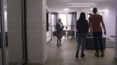 Couple entering and looking at new apartment